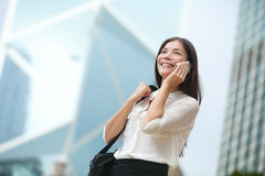 Business woman talking on smart phone in Hong Kong Royalty Free Stock Photo