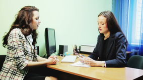 Business woman talking at table. Business woman talking at the table stock video footage