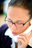 Business woman talking on telephone in office Stock Image