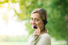 Business woman talking using her headset in the park Stock Images