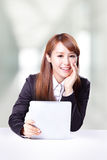 Business woman talking and using tablet pc Royalty Free Stock Photography