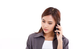 Business woman talking via her smartphone Stock Image