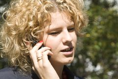 Business woman talks by phone Royalty Free Stock Photos
