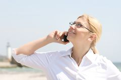 Business woman talks by phone Royalty Free Stock Image