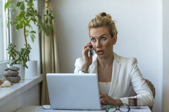 Business woman talks on the phone, conversation with the client. Royalty Free Stock Photos