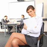 Business woman with team mates. Portrait of business woman with team mates discussing in the background Stock Photography