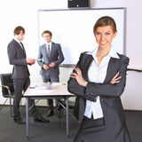 Business woman with team mates Royalty Free Stock Image