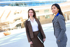 Business Woman Team at Office. Young attractive business women team at office building Royalty Free Stock Photo