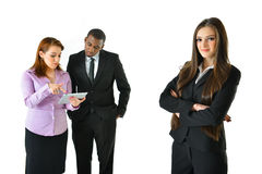 Business Woman and Team. Business women with arms crossed and her team Royalty Free Stock Photos