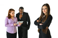 Business Woman and Team. Business women with arms crossed and her team Royalty Free Stock Images