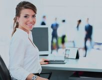 Business woman with team working on laptop. Business woman with team working on laptop Stock Photo