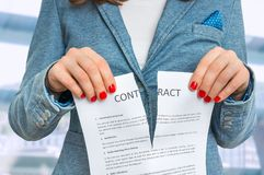 Business woman tearing contract in office Royalty Free Stock Photography