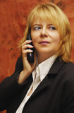 Business woman with telephone Royalty Free Stock Images