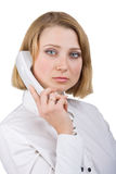 Business woman with a telephone receiver in hand Stock Photos