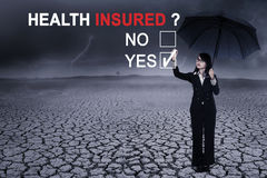 Business woman with text of health insured Royalty Free Stock Photos