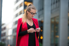 Business woman texting on cell phone and walking around financial district arean in New York Stock Photos