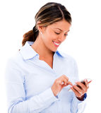 Business woman texting on her phone Royalty Free Stock Image