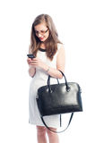 Business woman texting on her smartphone Royalty Free Stock Image
