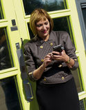 Business woman texting on mobile phone Royalty Free Stock Image