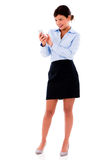 Business woman texting from a mobile phone Royalty Free Stock Photo