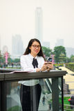 Business woman texting in modern environment. Outdoors royalty free stock photography
