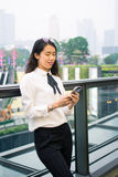 Business woman texting in modern environment. Outdoors royalty free stock photo