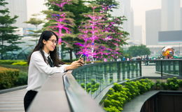 Business woman texting in modern environment. Outdoors stock image