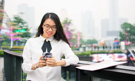 Business woman texting in modern environment. Outdoors Stock Photography