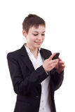 Business woman texting on phone Royalty Free Stock Photos