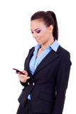 Business woman texting on phone Royalty Free Stock Photography