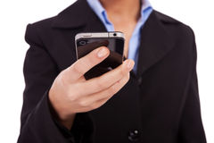 Business woman texting on a smartphone Stock Photography