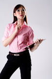 Business woman thinking. Confidence business woman thinking what to write Royalty Free Stock Image