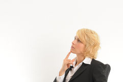Business woman thinking. Young business woman thinking about problems and solutions Stock Photo
