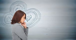 Business woman thinking against business doodle and blurry blue wood panel Stock Photos