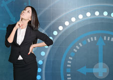 Business woman thinking on background of the clock Royalty Free Stock Images