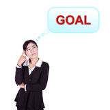 Business woman thinking about goal Stock Photo