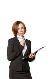 Business woman thinking while holding checklist. Stock Photos