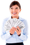 Business woman thinking how to spend money Royalty Free Stock Photos