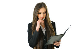 Business Woman Thinking. Business woman looking at her work and thinking Royalty Free Stock Photography