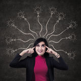 Business woman thinking many ideas Stock Photo