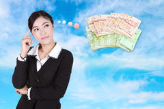 Business woman thinking about money Royalty Free Stock Images
