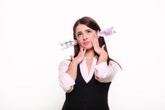 Business woman thinking. Money in the ears Stock Photos