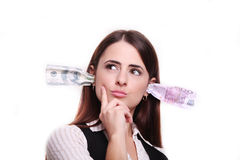 Business woman thinking. Money in the ears Royalty Free Stock Photography