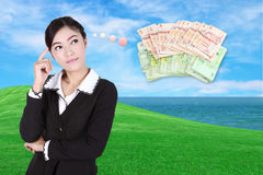 Business woman thinking about money Royalty Free Stock Photo