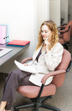 Business woman thinking at office desk Stock Photos