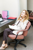 Business woman thinking at office desk Stock Photography