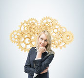 Business woman is thinking about optimisation of the business process. A concept of business management solutions. Beautiful blonde business woman is thinking Royalty Free Stock Images