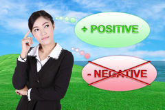 Business woman thinking about positive with green grass field an. D sea background Royalty Free Stock Photography