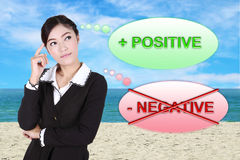 Business woman thinking about positive with sea beach and sky. Background Stock Image