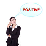 Business woman thinking about positive thinking. Isolated on white background Royalty Free Stock Image